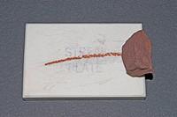 Streak plate test of the mineral Hematite.
