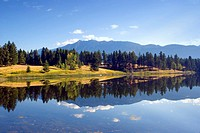 Mountains reflected in lake, Campbell Myer Rest Area, British Columbia, Canada