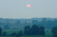 Sunrise, overlooking Oak Ridges Moraine western terminus, near Orangeville, ON, Canada