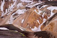 Colourful mountains, patches of snow. Landmannalaugar, South Iceland.