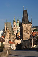 Charles Bridge, Little Quarter Bridge Tower and Church of St. Nicholas, Prague, Czech Republic.