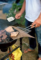 A man grilling meat.