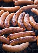 Sausages on a grill.