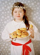 A girl celebrating Lucia in Sweden.