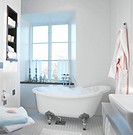 A bathtub with foam bath in a bathroom Sweden.