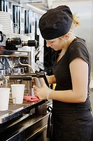 A woman working in a café Sweden.