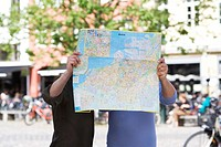 Two men with a map in Malmo Sweden.