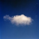 A white cloud on the blue sky