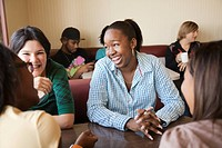 Young women sitting at table in diner