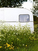 An old caravan in a field Smaland Sweden.