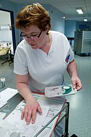 Photo essay at the department of dermatology at the Bocage hospital, University Hopital of Dijon, France. A nurse about to do a blood sampling.