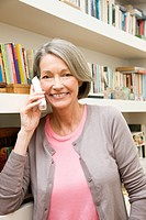 Mature woman using telephone