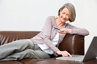 Mature woman using internet banking