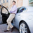 Businessman leaning against a car, Biltmore Hotel, Coral Gables, Florida, USA