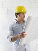 Man is reading construction plans