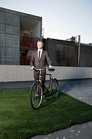 Businessman with bicycle (thumbnail)