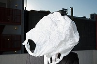 Plastic bag covering businessman's face