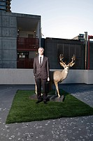 Businessman with deer (thumbnail)