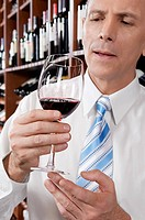 Businessman holding a wine glass