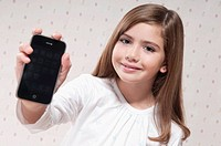 Portrait of a girl showing a mobile phone