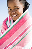Tween girl wrapped in a towel