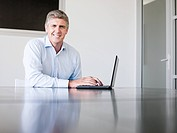 Mature businessman using a laptop computer
