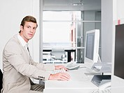 Young businessman at a computer