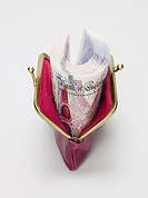 Twenty pound notes in a purse