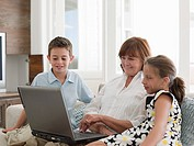 Woman and grandchildren with laptop