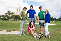 Five friends having fun in a golf course, Biltmore Hotel, Biltmore Golf Course, Coral Gables, Florida, USA
