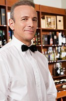 Portrait of a waiter smirking
