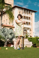 Woman playing croquet in a hotel lawn, Biltmore Hotel, Coral Gables, Florida, USA