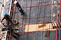 High angle view of three construction workers working at a construction site