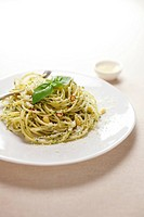 Plate of basil spaghetti, white background