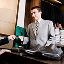 Businessman paying by a credit card in a store
