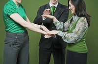 Business executives stacking hands on each other