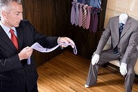 Businessman selecting a tie in a clothing store