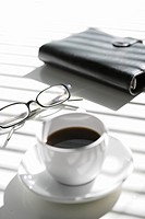 Coffee cup, Glasses and Diary