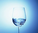 Water swirling in a wineglass