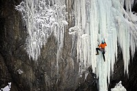 Ice climber ascends a large icefall in Southcentral Alaska