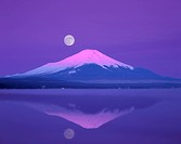 Mt. Fuji below full moon, Yamanashi Prefecture, Japan
