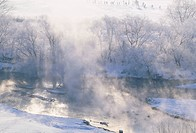 Frosted trees and river in fog. Hokkaido, Japan