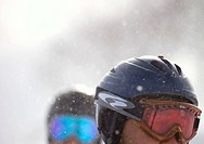 People wearing ski goggles and helmets