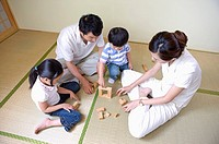 Family, family playing block game together