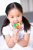 Family, a girl licking her lollipop, Portrait