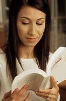 Darkhaired Woman reading a Novel _ Print Media _ Home