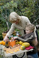 Grandmother and grandson planting bulbs