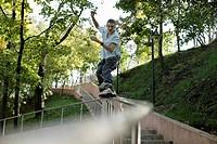 Boy inline skating over a balustrade