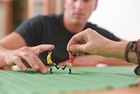 People playing with a Table Soccer Game Detail