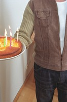 Man holding a Birthday Cake cropped